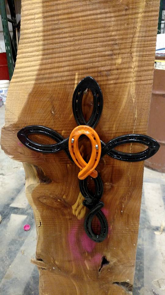 Cross made from Horse Shoes with Cancer Ribbon in the center