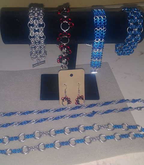 Chain Mail Jewelry on a stand