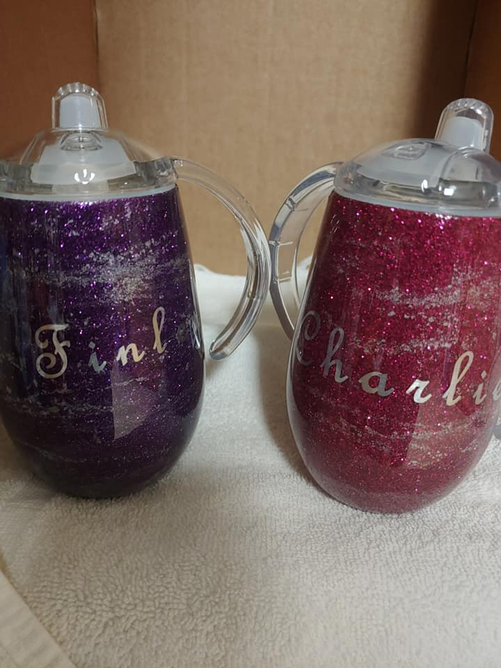 Purple and Red Sippy Cups.